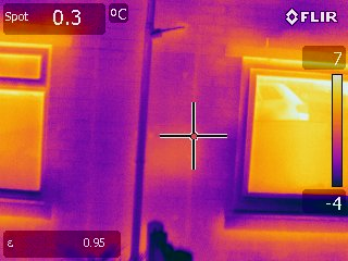 Thermal image of increased heat loss through incomplete fill of cavity wall